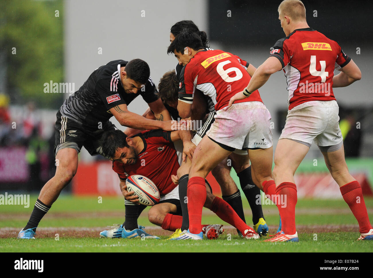 Glasgow, Scotland, UK. 4th May 2014.  Philip Mack of Canada is caught in possession during the Cup final match between New Zealand and Canada at the HSBC IRB Glasgow Sevens rugby tournament being held at the Scotstoun Stadium in Glasgow. Photo by Roger Sedres/ImageSA/Alamy Live News - Stock Image