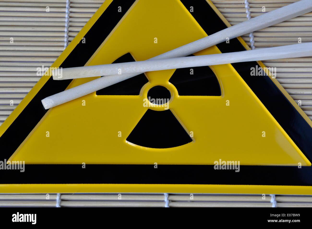(ILLUSTRATION) Chopsticks lie on a radioactivity warning sign in Germany, 01 April 2011. Photo: Berliner Verlag/Steinach Stock Photo