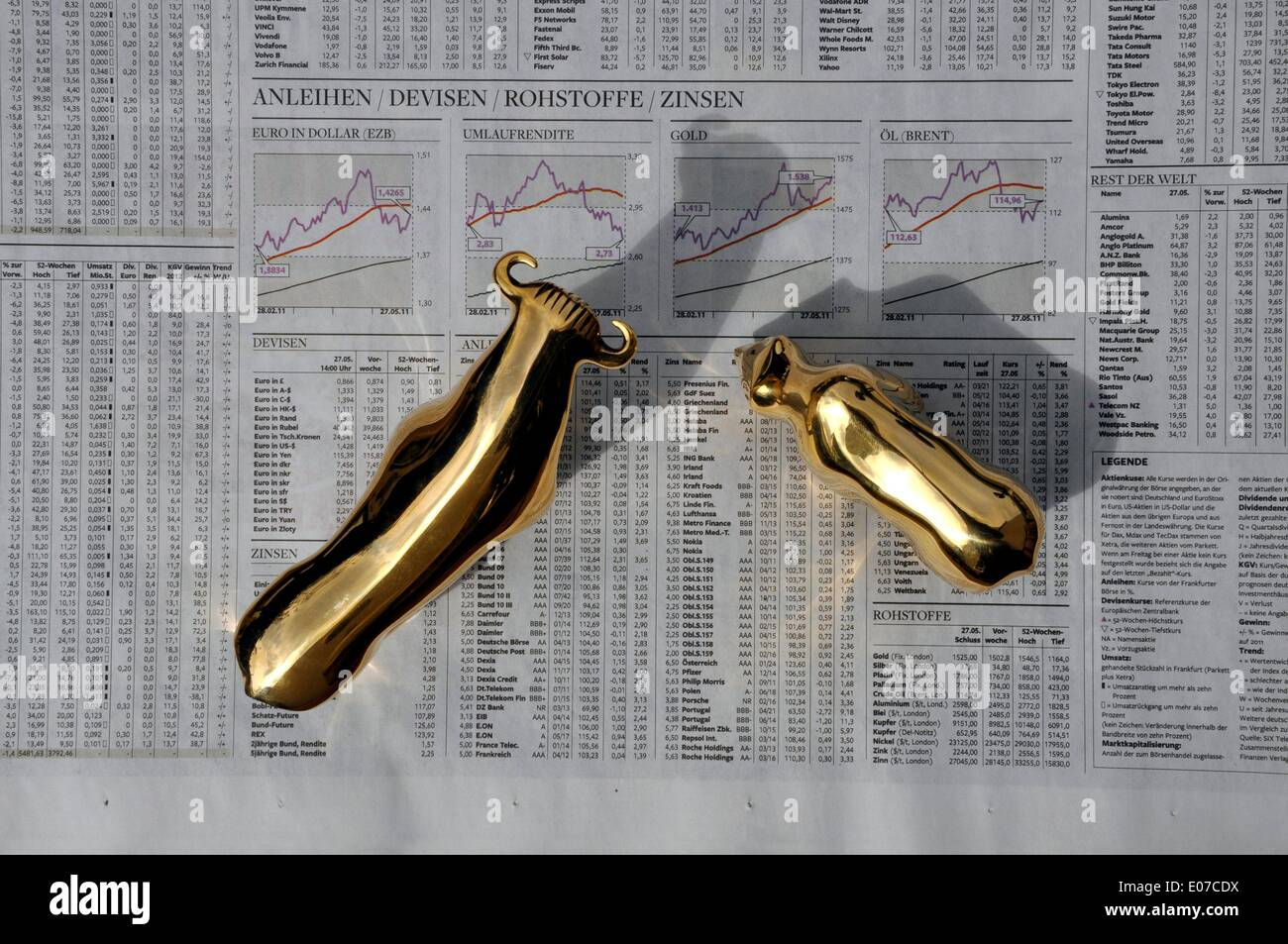 Illustration - Golden midget figures of the bear and the bull stand on security papers in Germany, 29 May 2011. Stock Photo