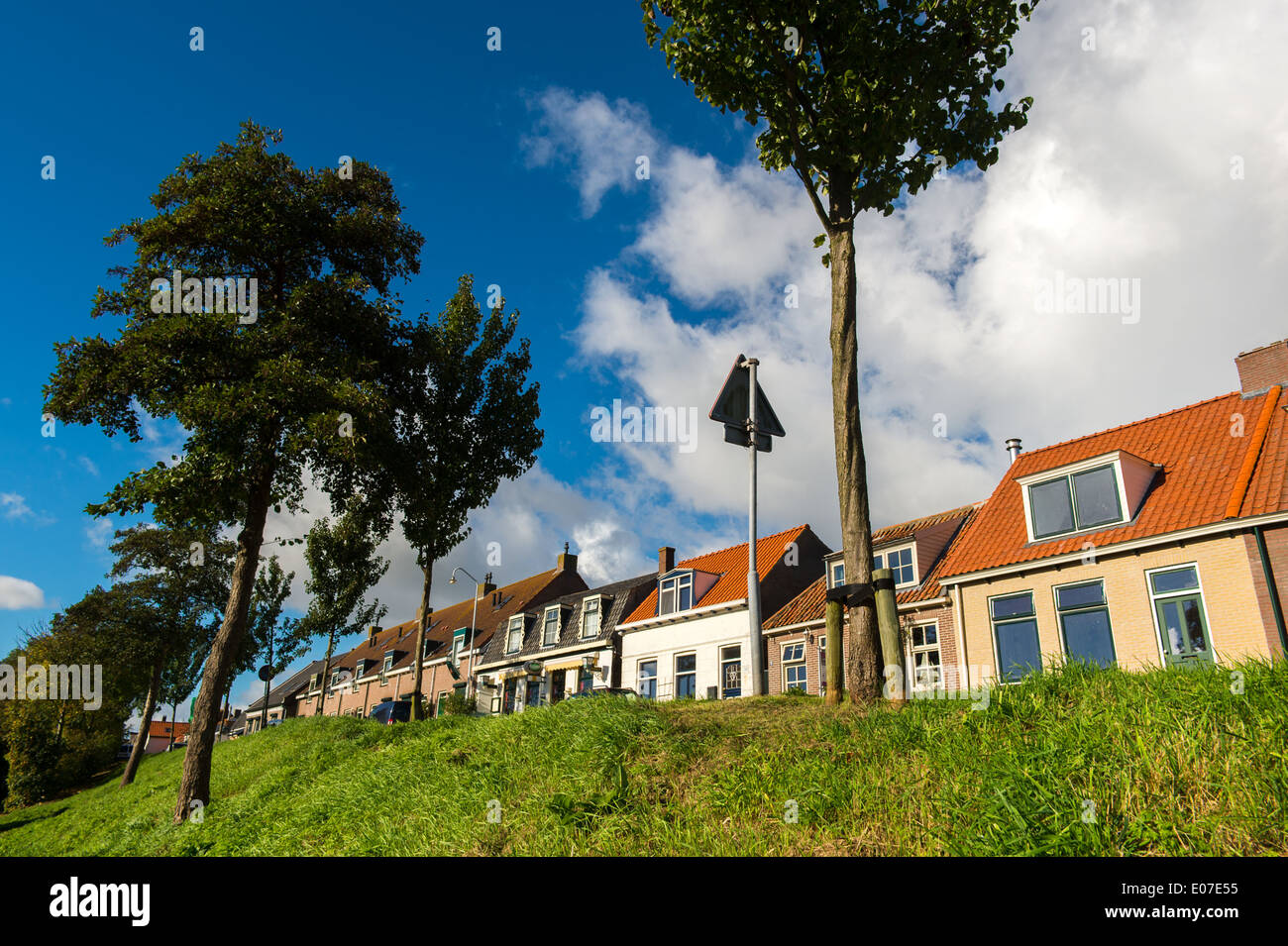 Row dutch dike houses in village Zonnemaire at Zeeland - Stock Image