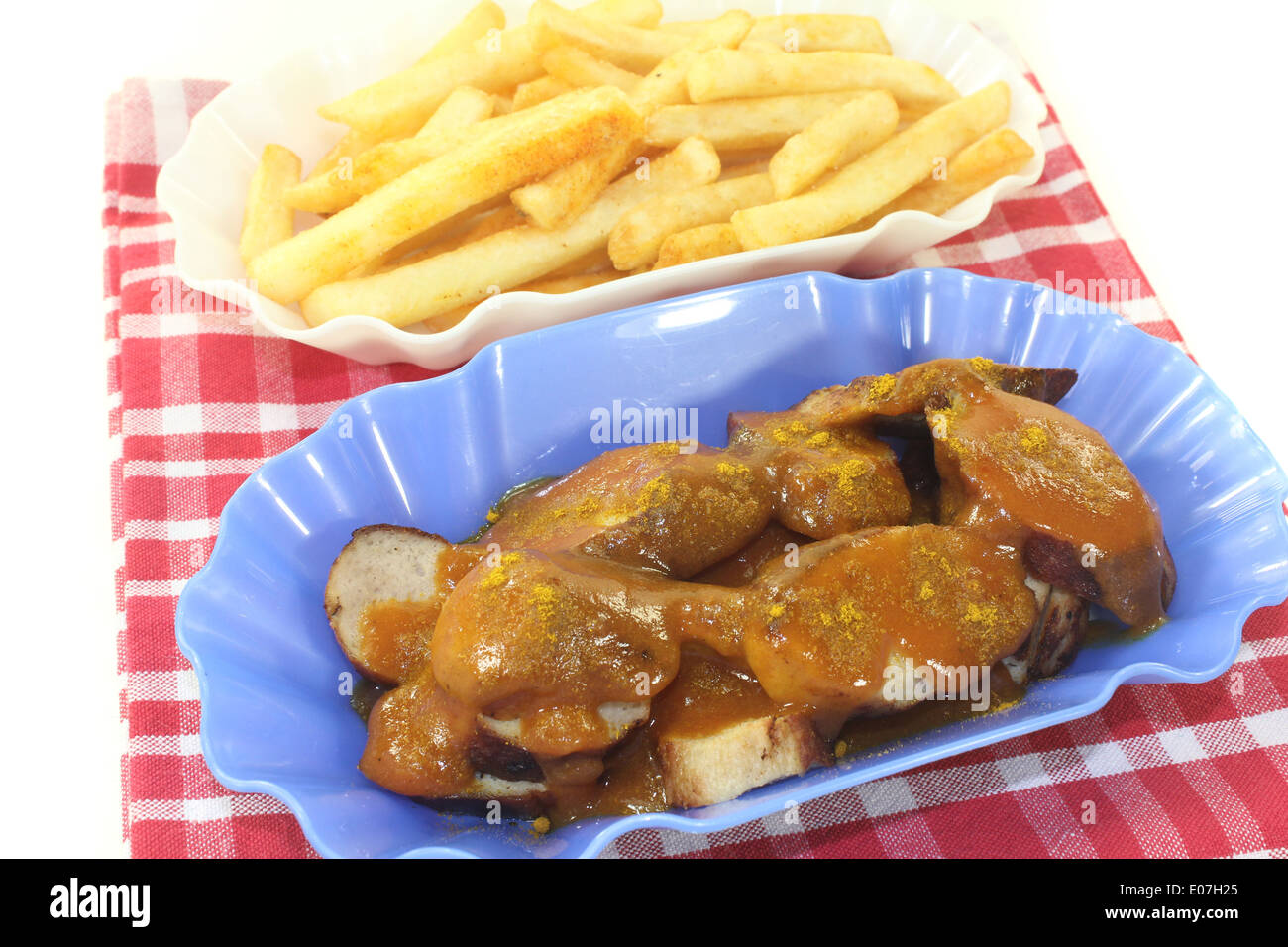 Currywurst with french fries on a light background Stock Photo