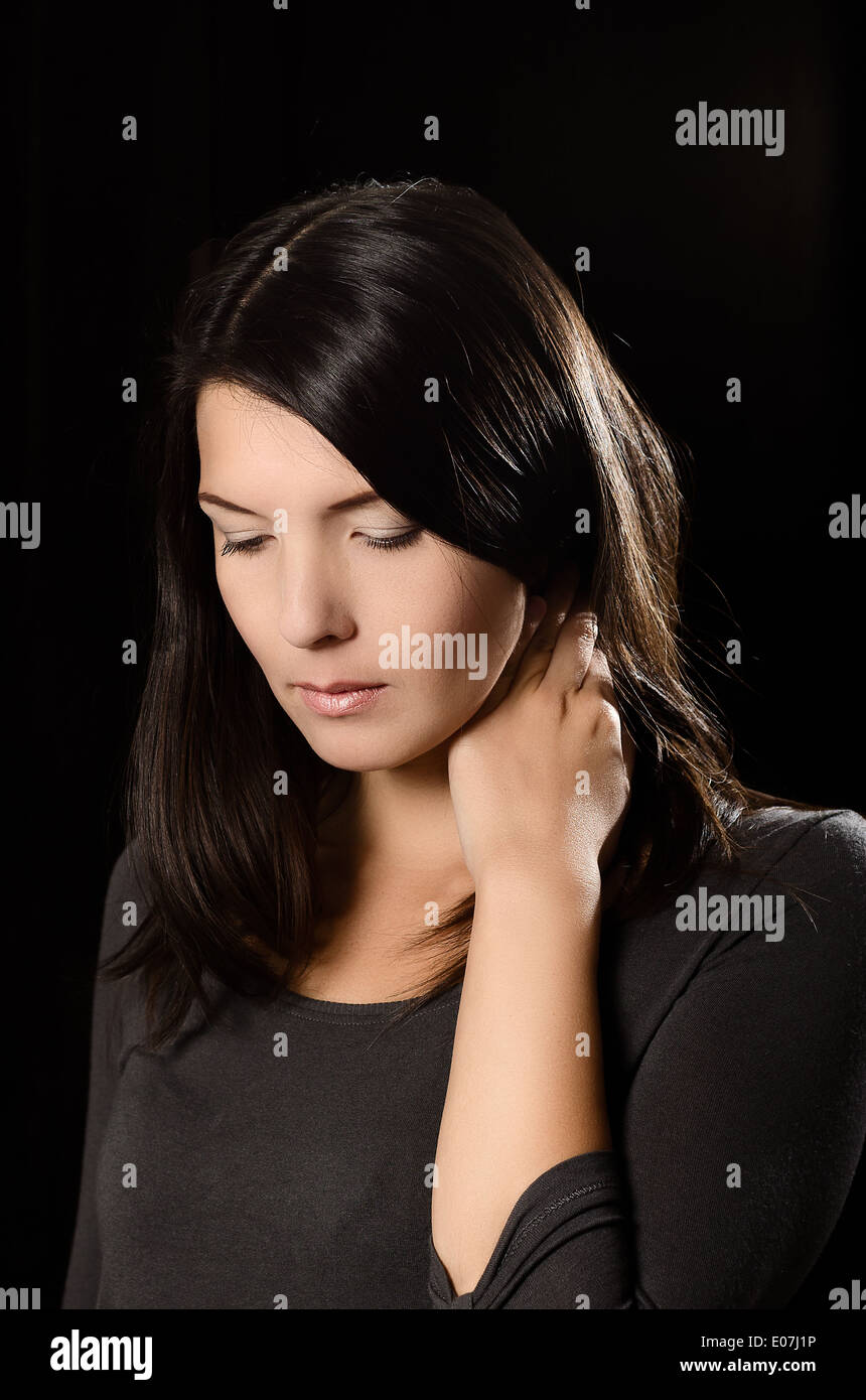 Melancholy woman with a serious expression - Stock Image