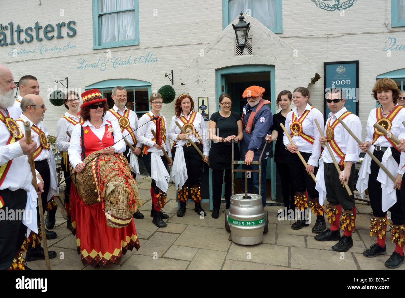 Skipper of wherry Albion with members of Golden Star Morris with the first keg of Jenny Morgan beer at Maltsters Stock Photo