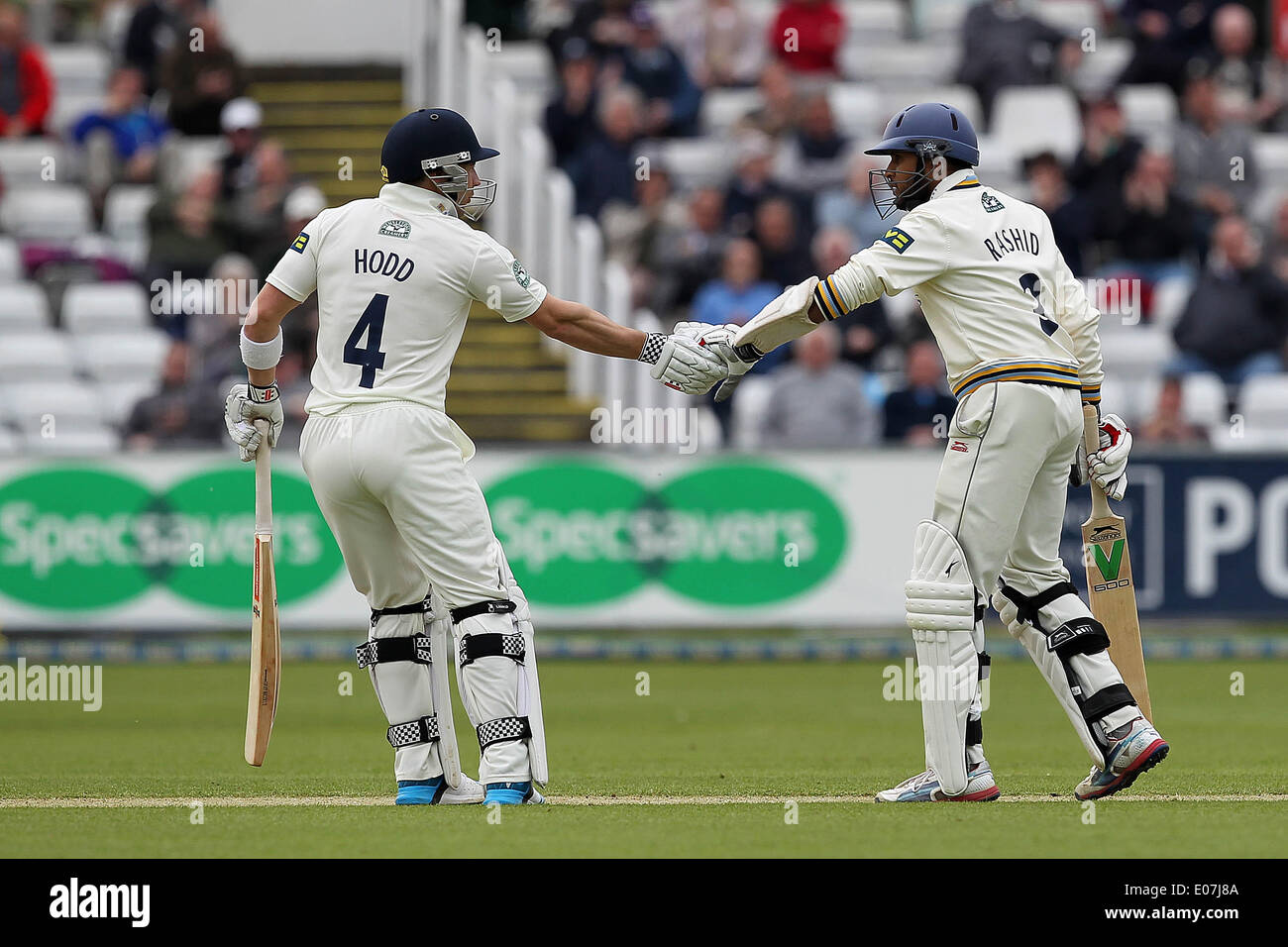 Chester Le Street, UK. 5th May 2014. Yorkshire's Andrew Hodd congratulates team mate Adil Rashid on reaching 50 on Day two of the LV County Championship Division One game between Durham CCC & Yorkshire CCC at Emirates Durham ICG in Chester Le Street on Monday May 5th 2014. Credit:  Mark Fletcher/Alamy Live News - Stock Image