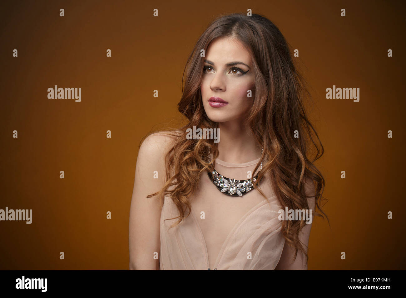 Young woman with long hair, portrait - Stock Image