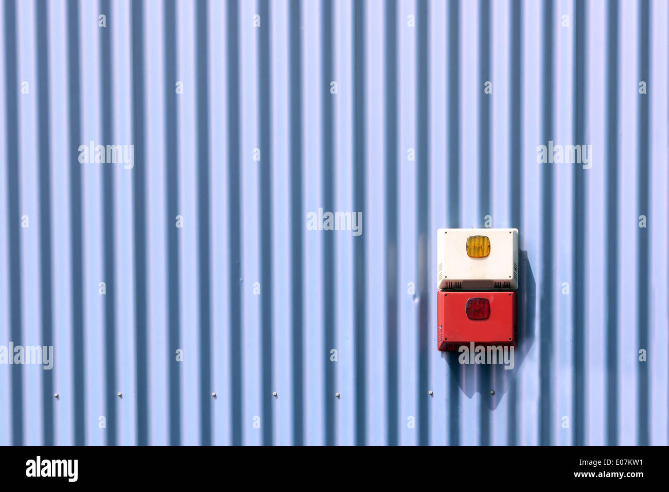 seucurity system with alarm on industrial wall - Stock Image