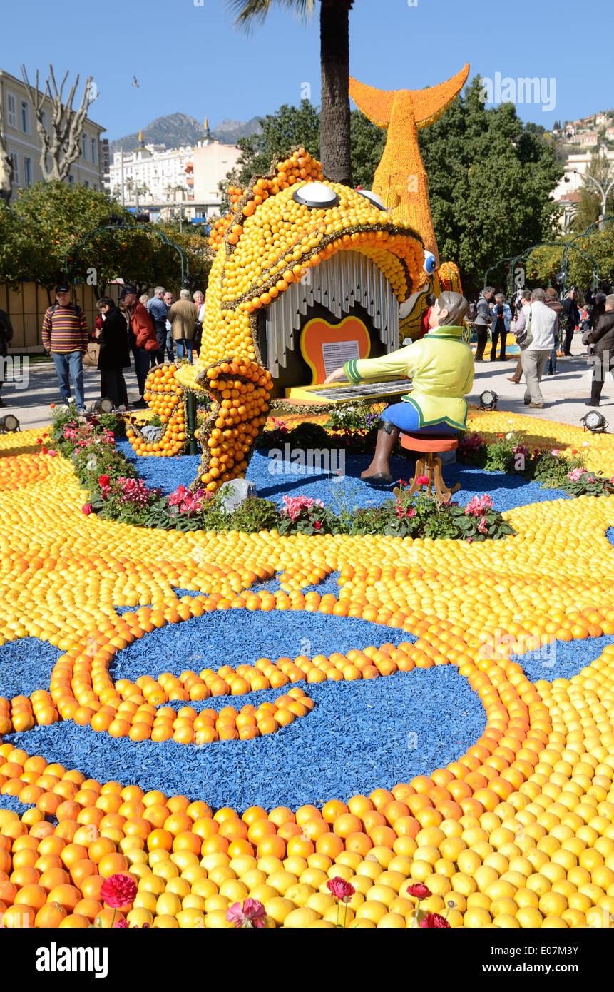 Fish-Shaped Piano made of Oranges or Orange Sculpture at the Lemon Festival or Fête du Citron Menton Alpes-Maritimes France - Stock Image