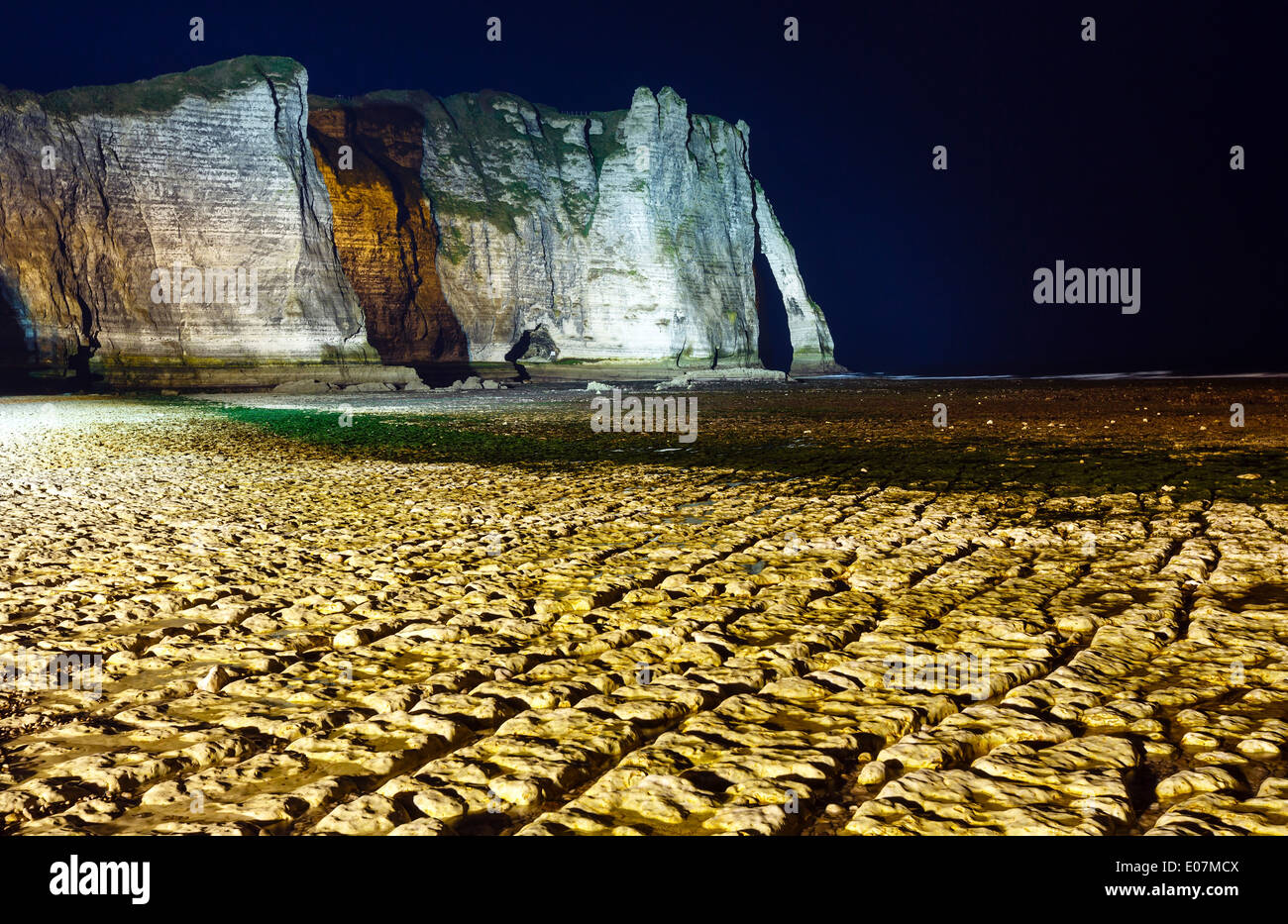 One of the three famous white cliffs known as the Falaise de Aval. Etretat, France. Night scene. March 2014. - Stock Image