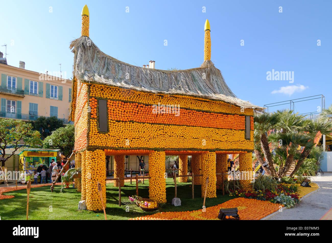 Fantasy House from Papua New Guinea Built of Oranges at the Annual Lemon Festival Menton Alpes-Maritimes France - Stock Image