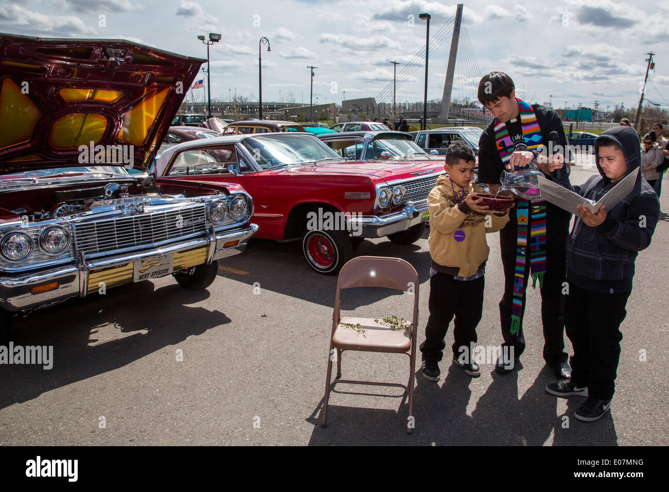 Detroit, Michigan - Rev. John Cummings, pastor of Grace In Action Lutheran Church, performs the Blessing of the Lowriders. - Stock Image