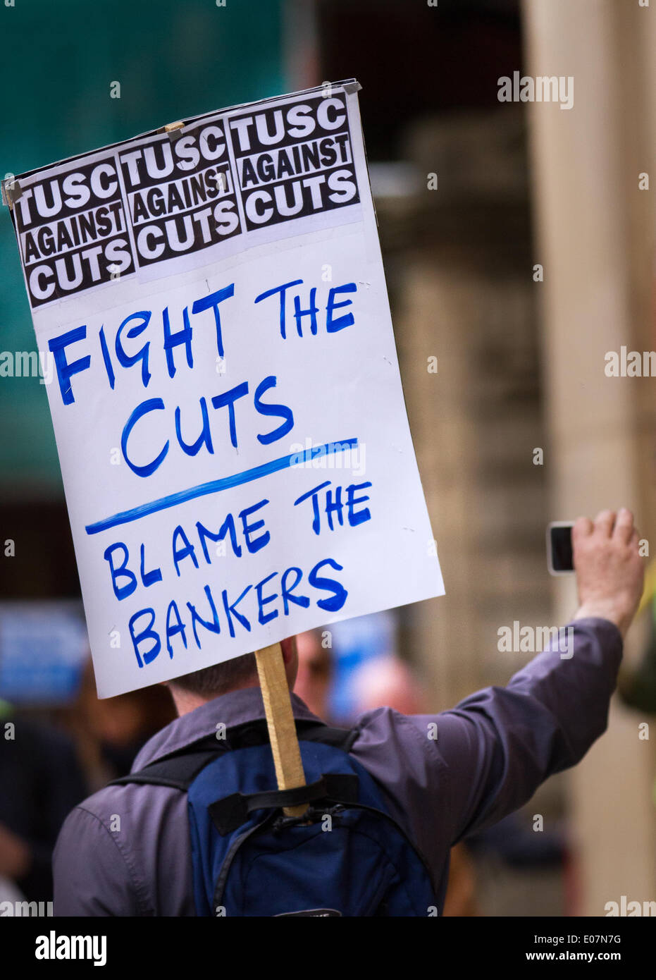 Salford, Manchester, UK  5th May, 2014. Placard TUSC against the cuts.  'Fight the Cuts.  Blame the Bankers' poster at Salford's annual May Day Rally.  Manchester, Salford, Bury and Oldham Trades Union Councils organized this year's May Day event in Manchester, with the message `A Better Future for All Our Communities' to celebrate international workers day. Workers gathered at Bexley Square to hear speakers prior to marching to Cathedral Gardens. The themes this year included opposition to cuts, the Bedroom Tax and fracking. - Stock Image