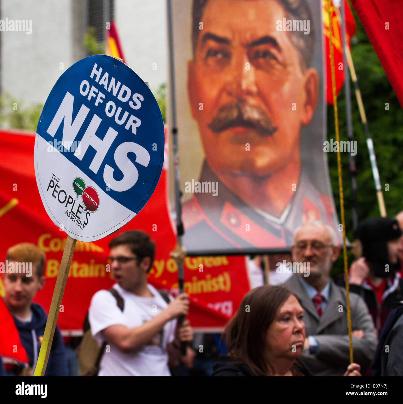 Salford, Manchester, UK  5th May, 2014. 'Hands of the NHS' and picture poster of Stalin, russia, communism, general at Salford's annual May Day Rally. Trades Union Councils organized this year's May Day event in Manchester, with the message `A Better Future for All Our Communities' to celebrate international workers day. - Stock Image