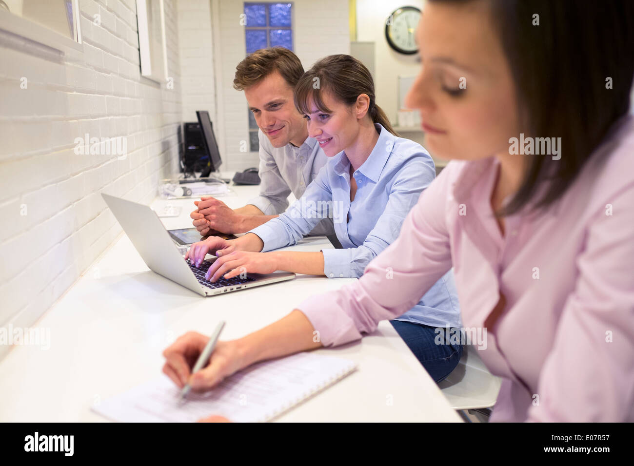 Business man woman colleagues computer startup coworking casual students - Stock Image