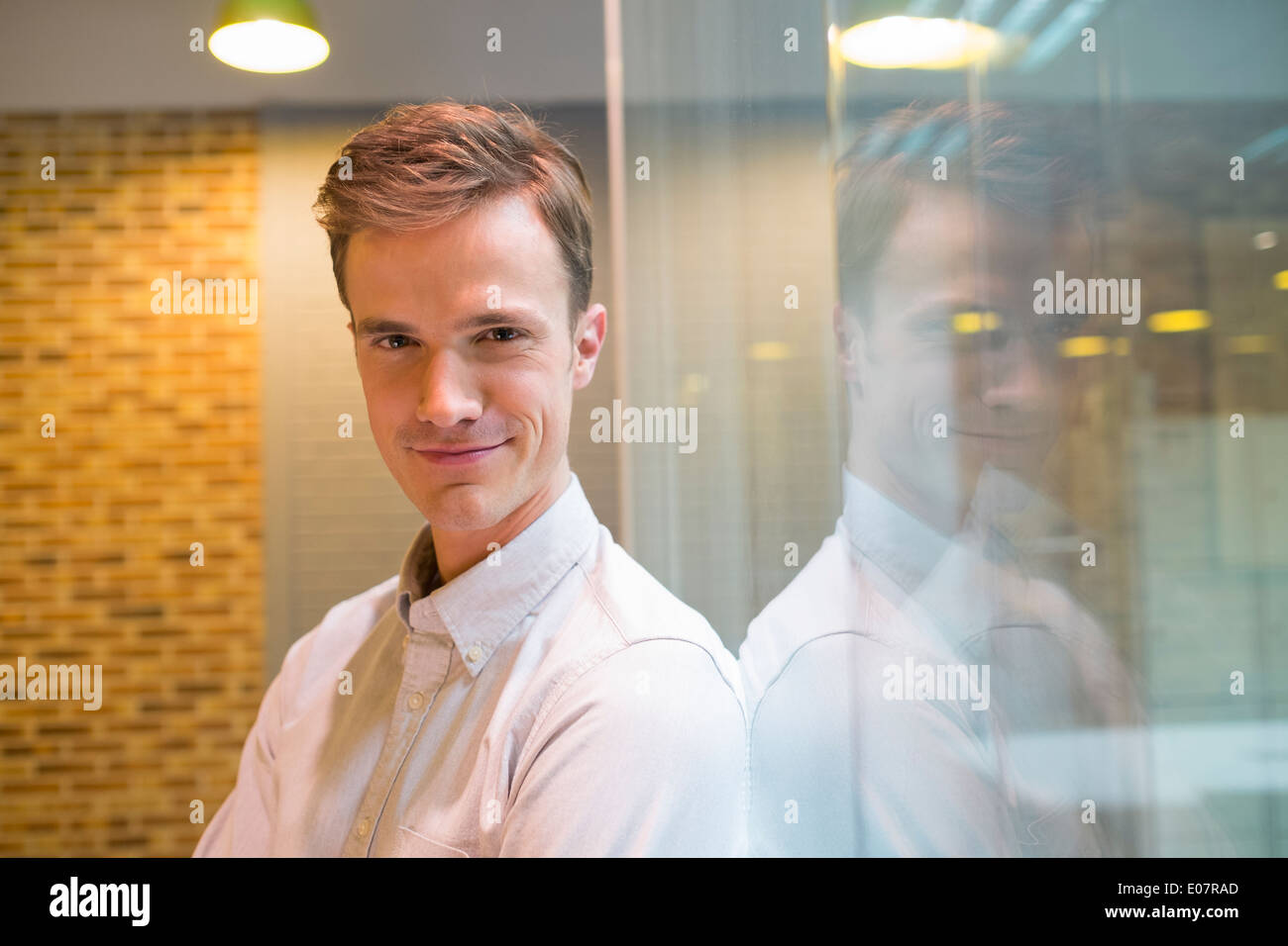 Male business startup looking camera student - Stock Image