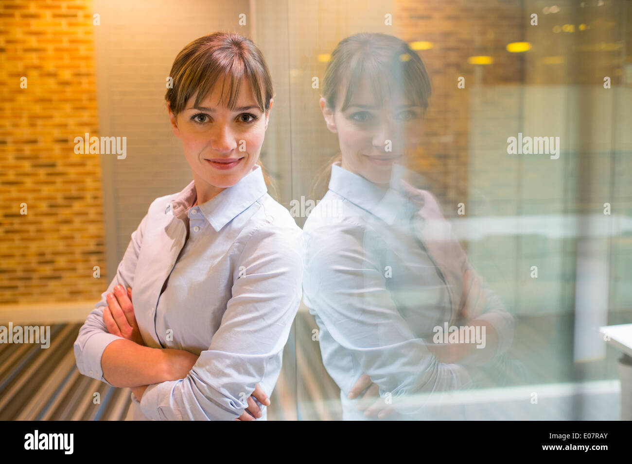 Female business startup looking camera student Stock Photo