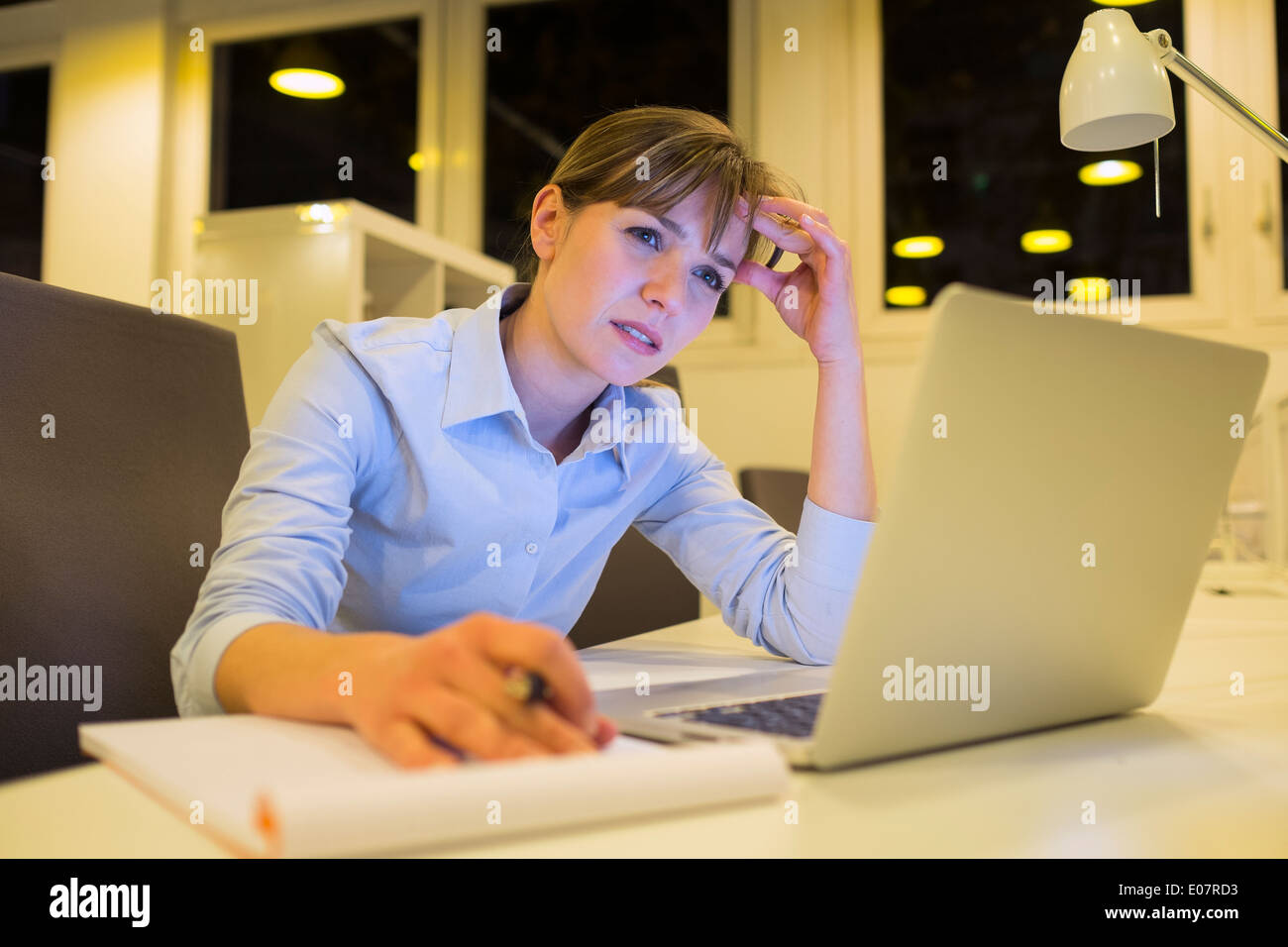 Female business tired working late startup student desk - Stock Image