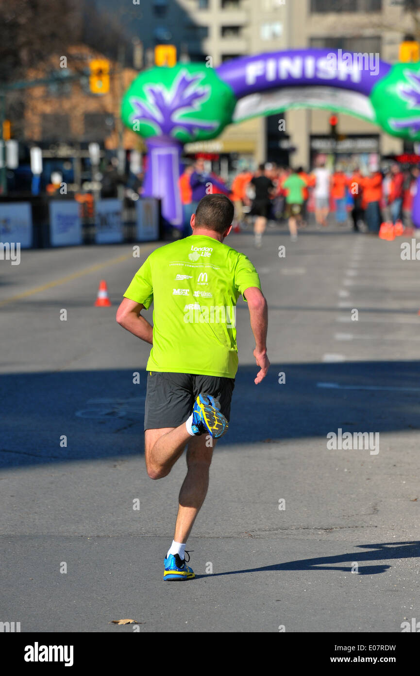 Runners participate in a charity road race in London, Ontario. - Stock Image