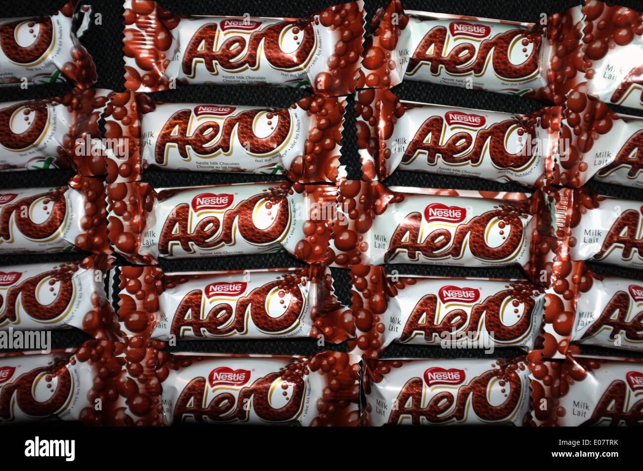 Aero chocolate bars photographed against a black background. - Stock Image