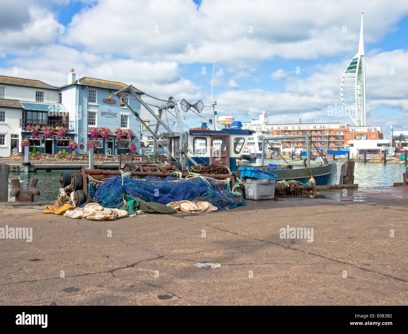 Fishing boat and nets on the quayside of Camber Wharf in Old Portsmouth , England Stock Photo