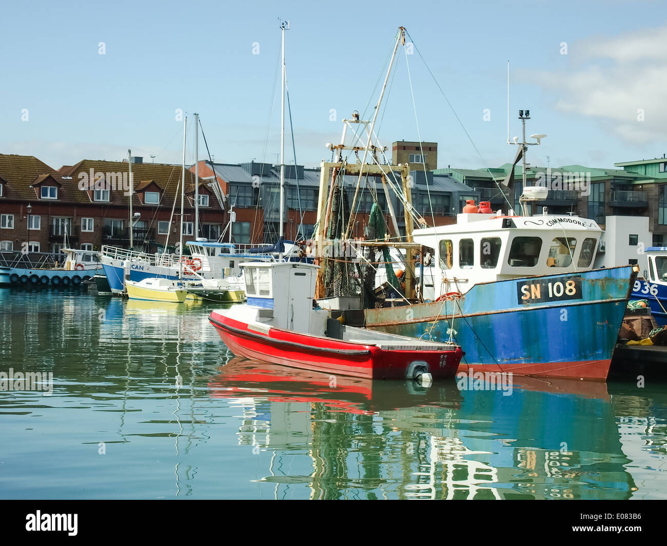 Fishing Boats tied up in Camber Wharf fishing docks in Old Portsmouth, England Stock Photo