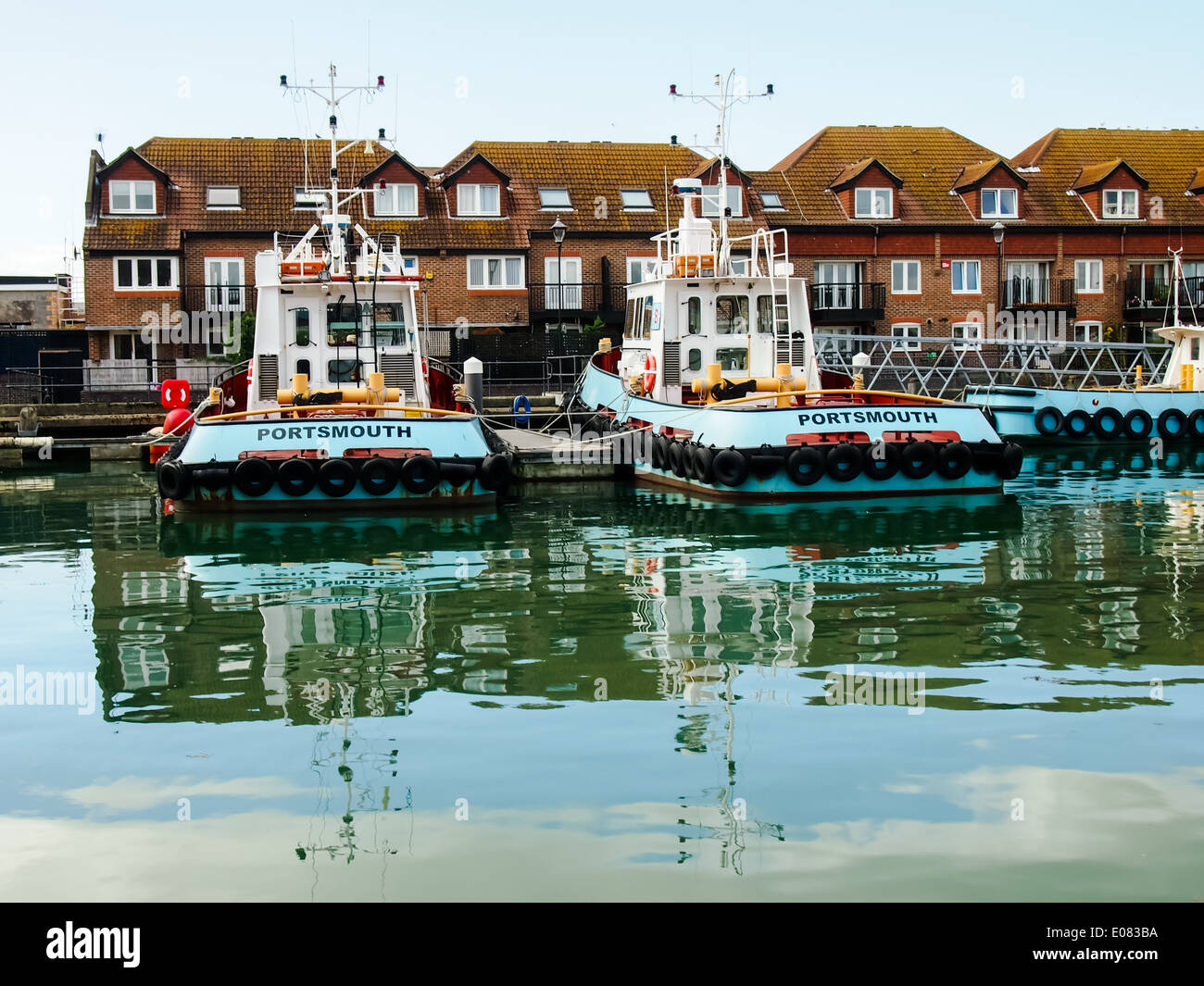 Blue tugs belonging to J Butcher and sons docked in Camber Wharf, Old Portsmouth, Hampshire - Stock Image