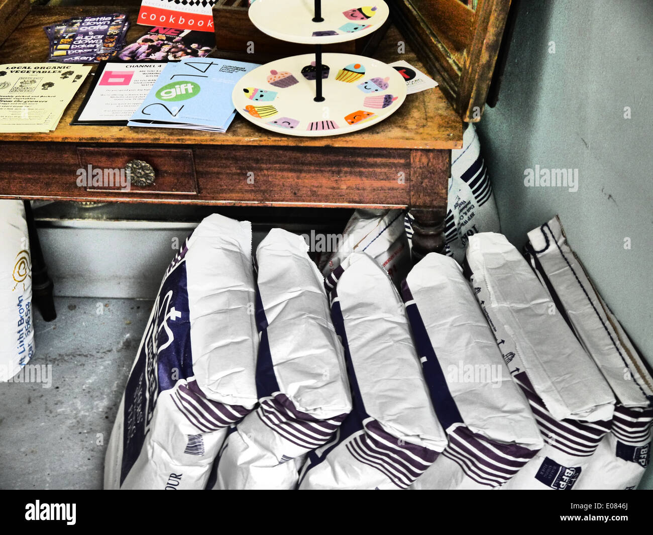 Creative abstract image of table and flour sacks in a craft bakery - colour - Stock Image