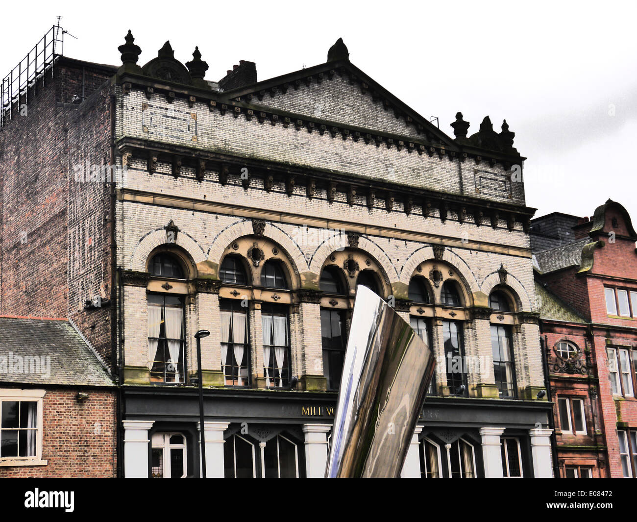 Creative image of Mills Volvo Tyne theatre with modern artwork in foreground, Newcastle upon Tyne, UK - Stock Image