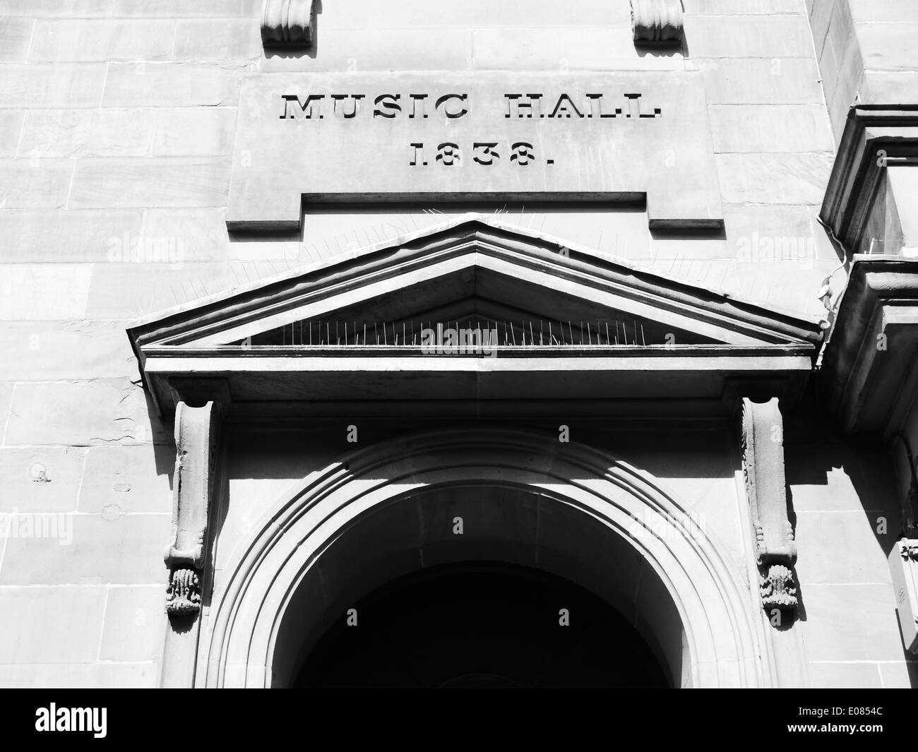 Architectural detail of an historic music hall building in which Charles Dickens appeared, Newcastle upon Tyne, England, UK. B&W - Stock Image