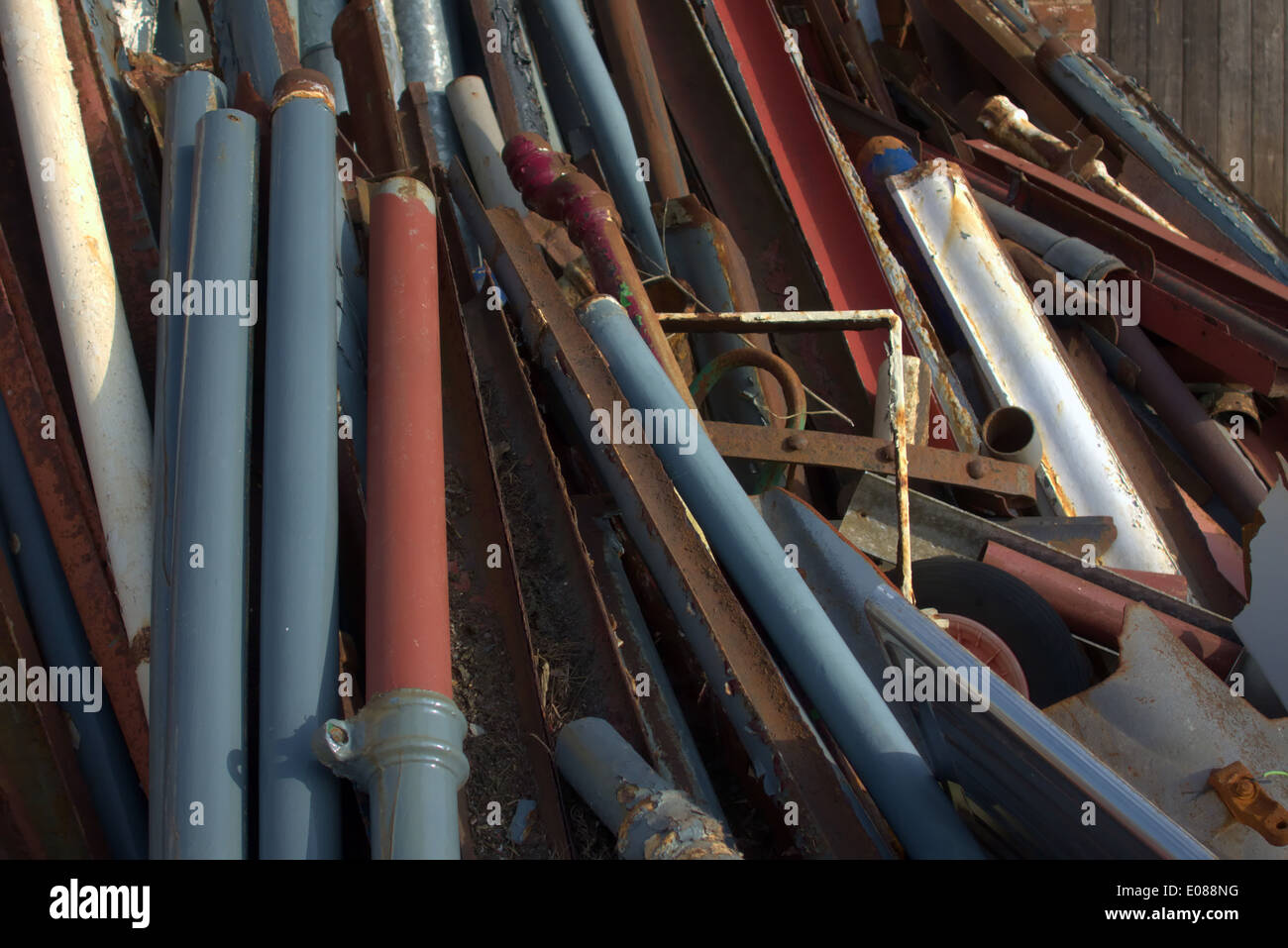 Reclaimed cast iron gutter and downpipe sections for recycling and reuse on repair and replacement work - Stock Image