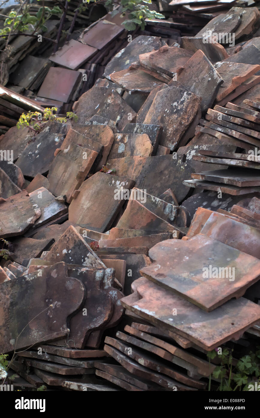 Reclaimed roofing tiles for recycling and reuse on repair and replacement work - Stock Image
