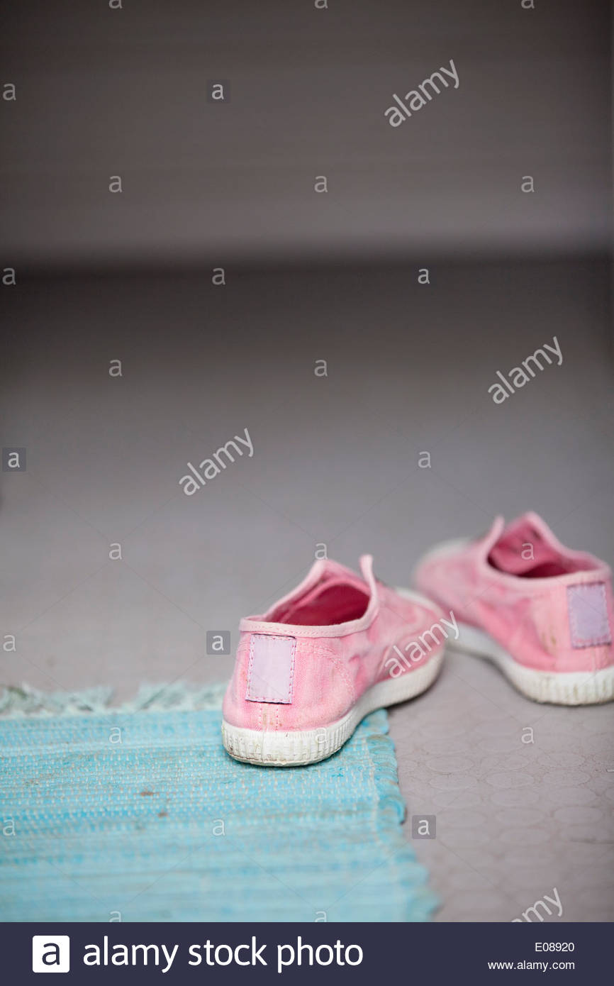 Pink shoes on floor - Stock Image