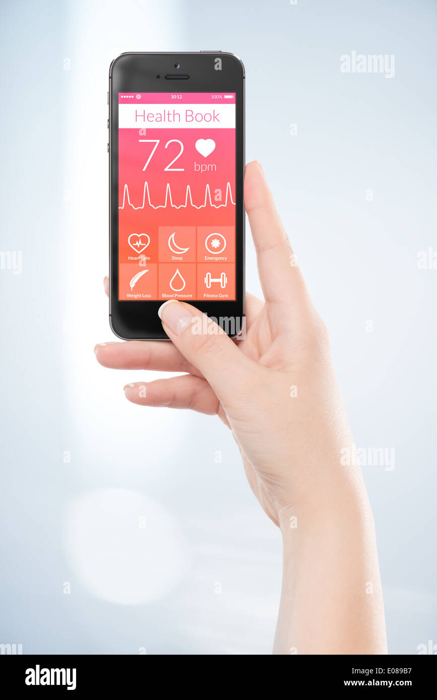 Woman hand is holding black mobile smart phone with health book app on the screen. - Stock Image