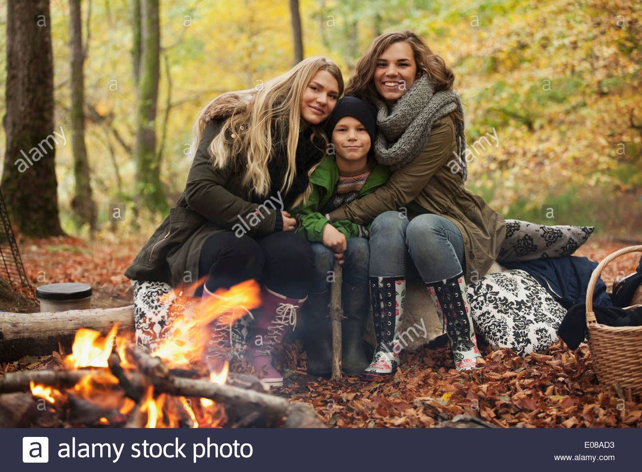 Portrait of sibling camping in forest - Stock Image