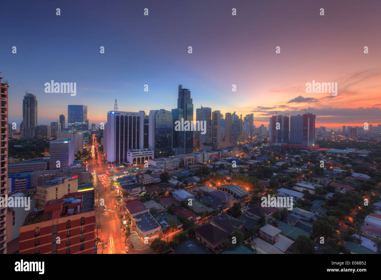 Philippines, Manila, Makati Business District, Makati Avenue and City Skyline - Stock Image