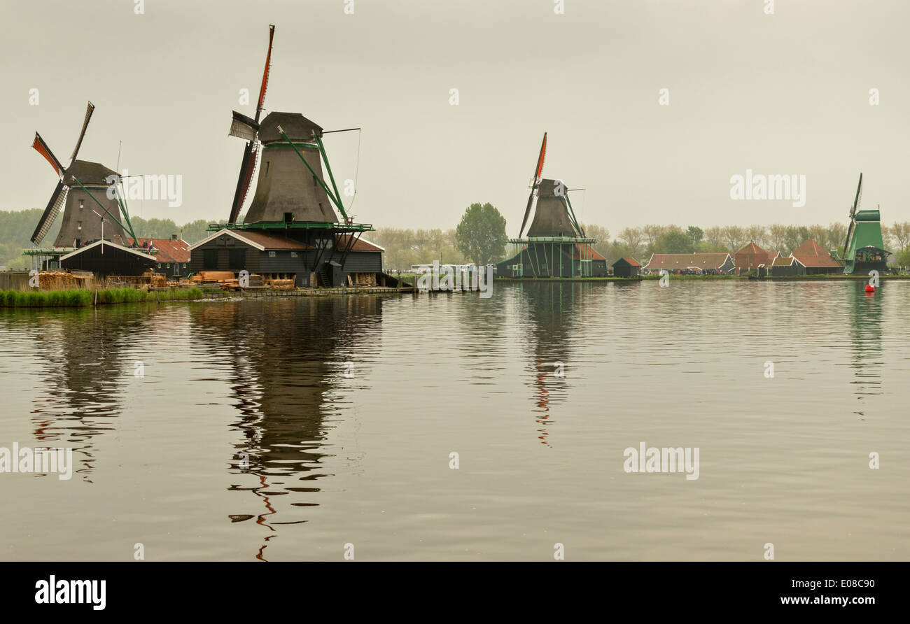 DUTCH WINDMILLS AND CANAL AT ZAANSE SCHANS WITH ORANGE SAILS HOLLAND - Stock Image