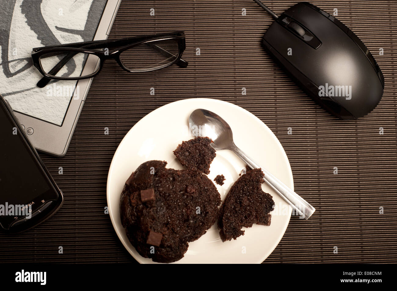 muffin and technology objects - Stock Image