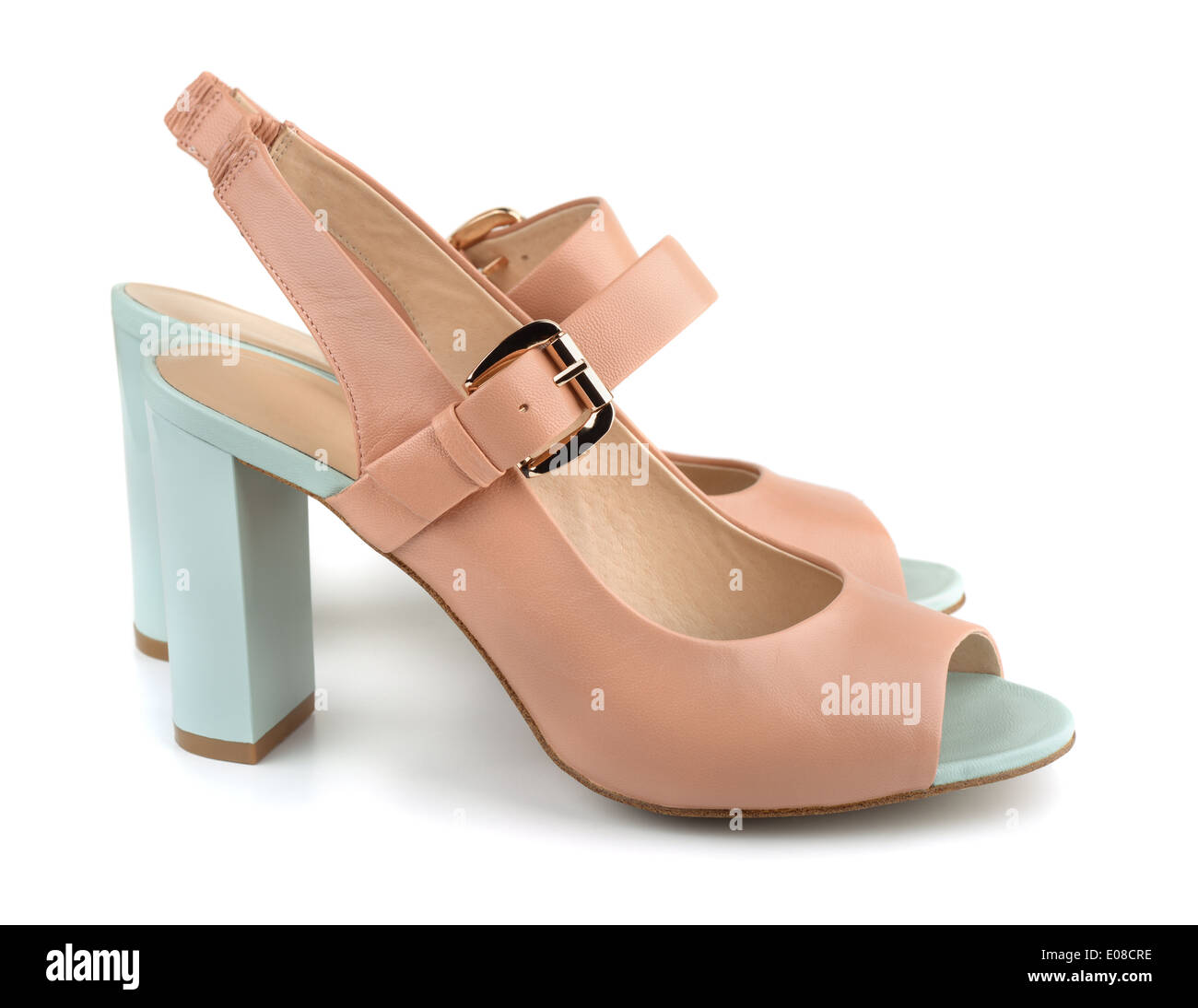 Pair of beige high heels shoes isolated on white - Stock Image
