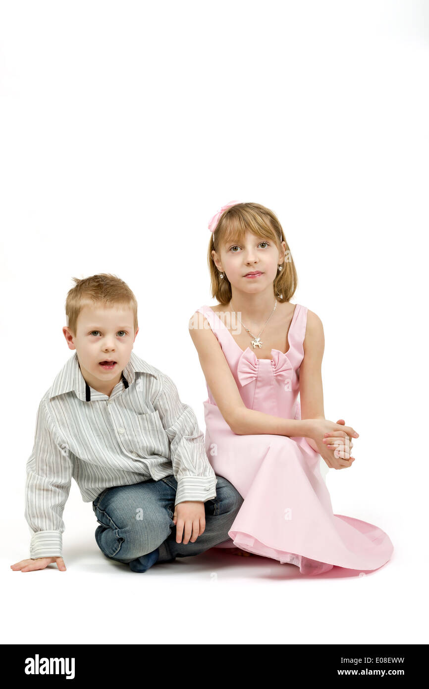 Studio portrait of siblings beautiful boy and girl on white background - Stock Image