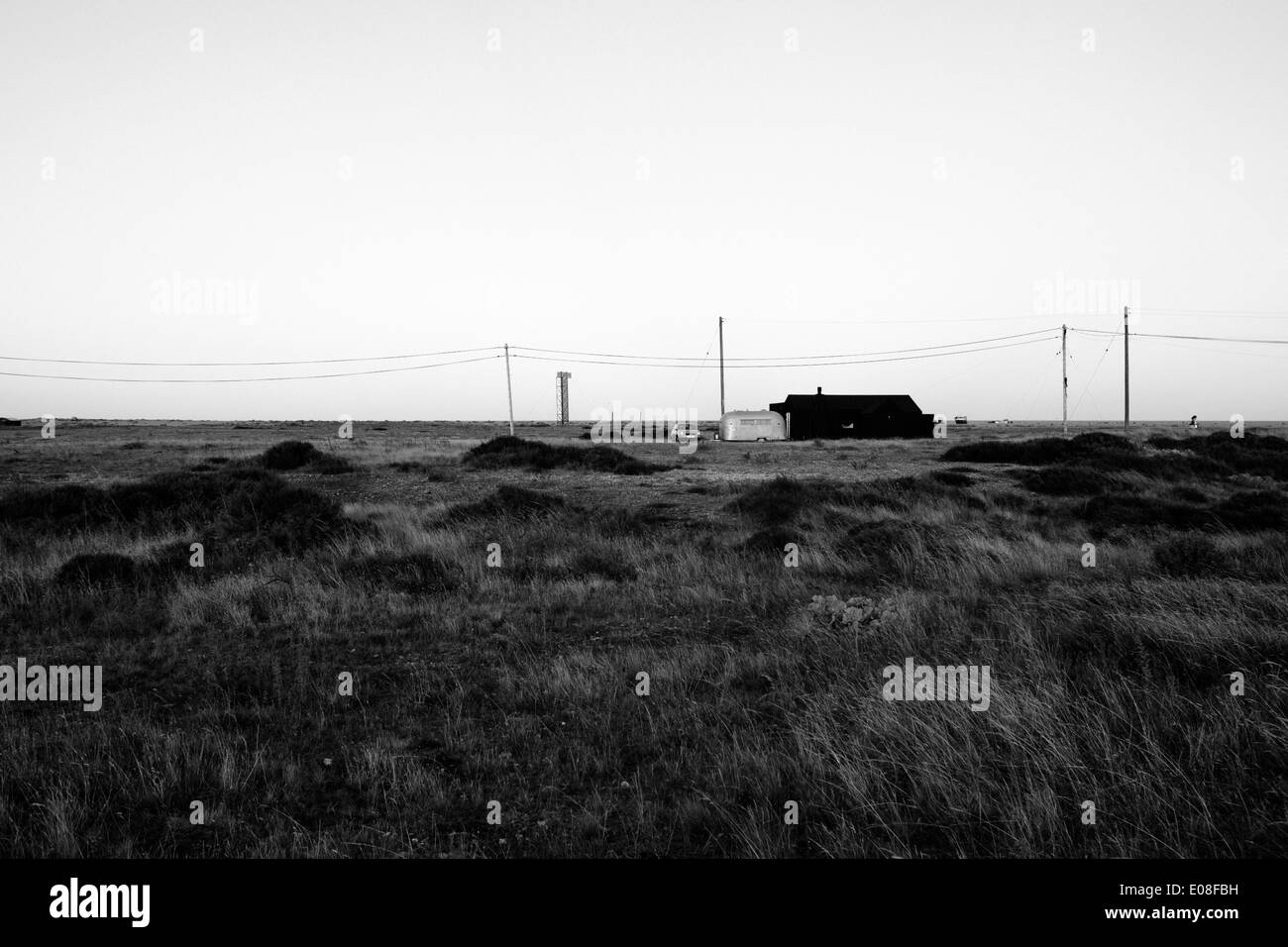Black and white landscape shot of desolate building in Dungeness, Kent, United Kingdom - Stock Image