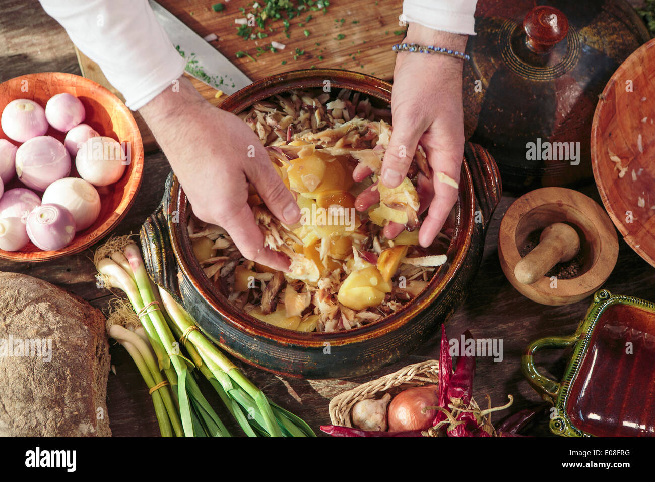 Person preparing food with many ingredients - Stock Image