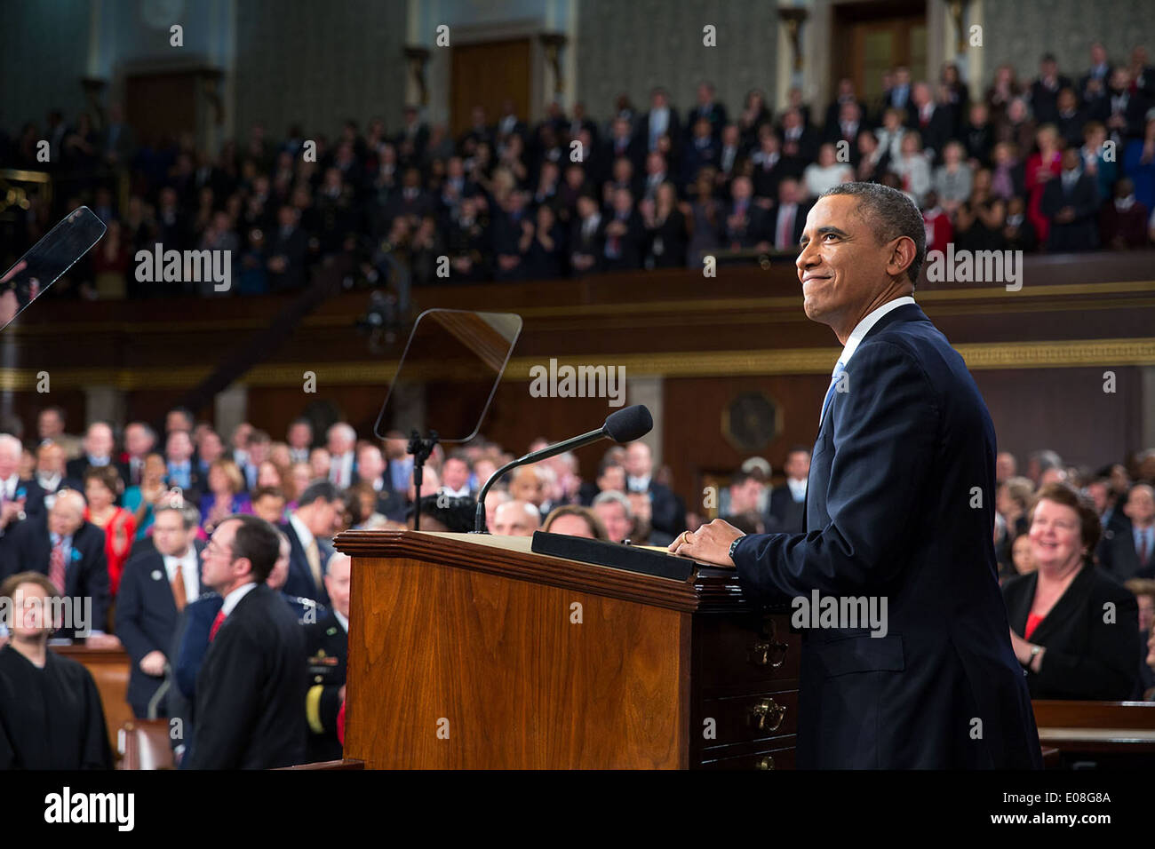 US President Barack Obama acknowledges applause before he delivers the State of the Union address in the House Chamber at the U.S. Capitol January 28, 2014 in Washington, DC. - Stock Image