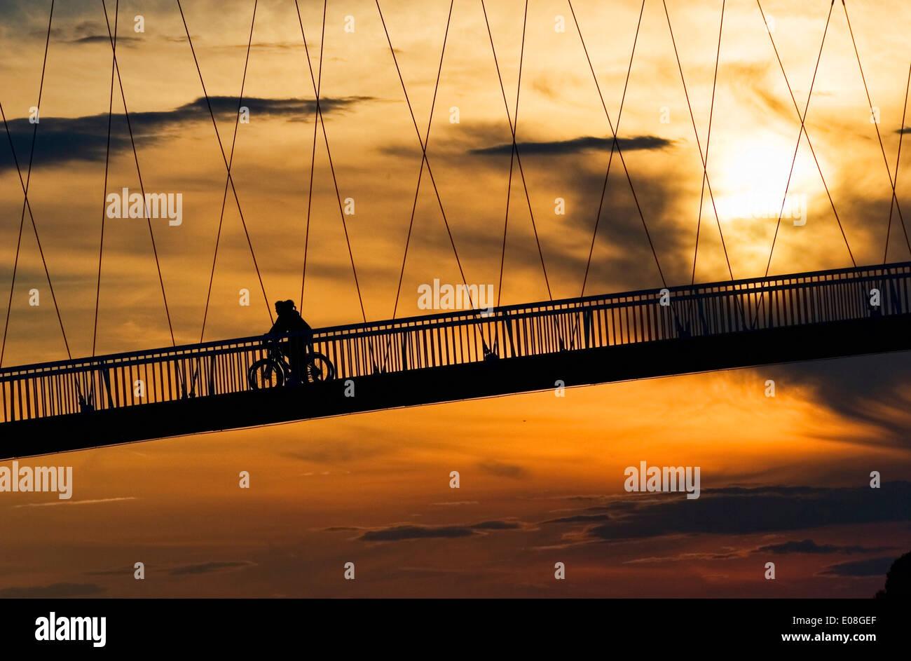 Pedestrian footbridge over Drava river at sunset, Osijek, Croatia - Stock Image