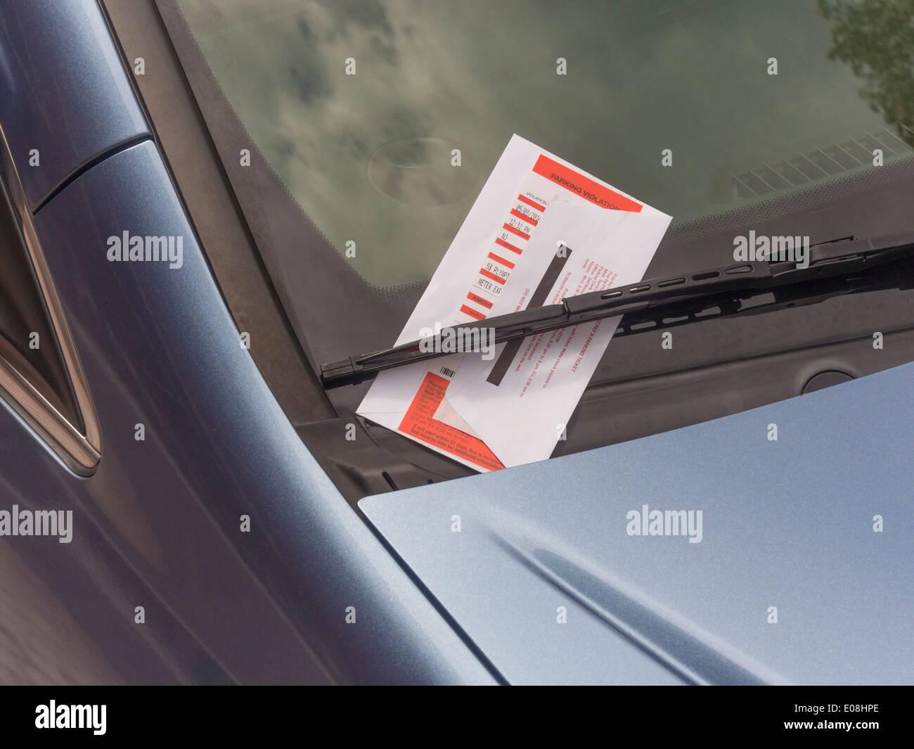 parking ticket on motor car windscreen or windshield. - Stock Image
