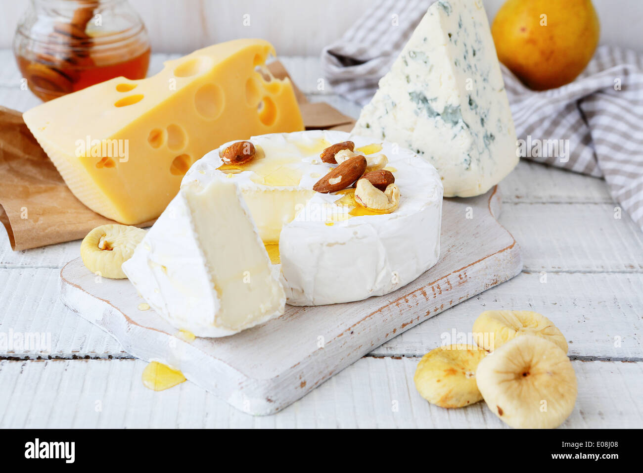 cheese platter with golden honey, food closeup - Stock Image