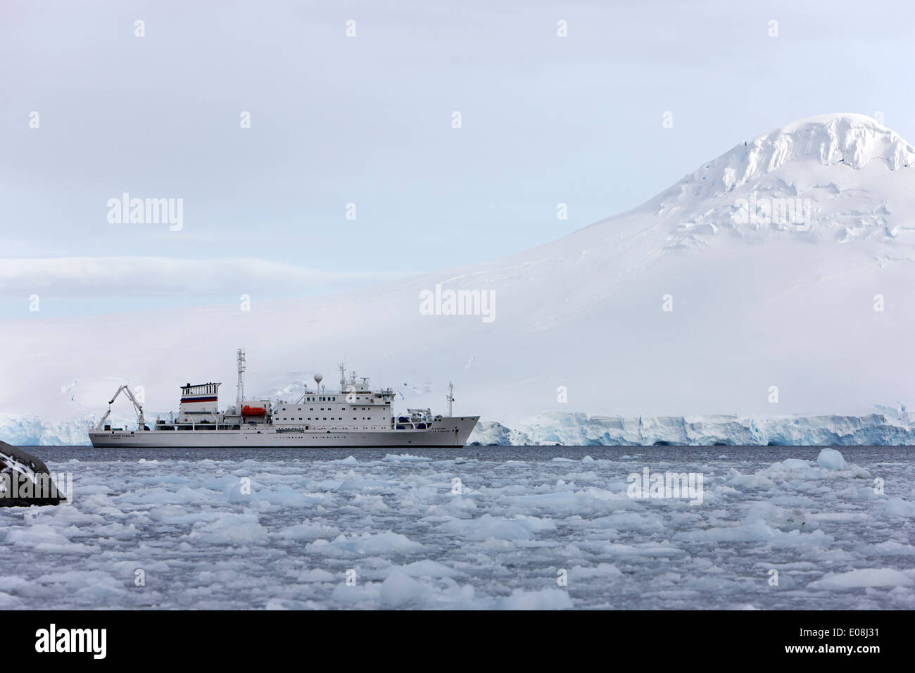 akademik sergey vavilov russian research ship in port lockroy as brash sea ice forming winter closing in Antarctica - Stock Image