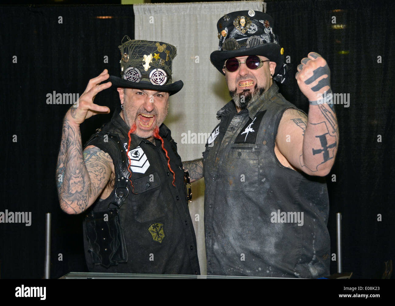 Portrait if Syx (l) and his friend Seven in top hats at the New York Tattoo Festival in Uniondale, Long Island, New York - Stock Image