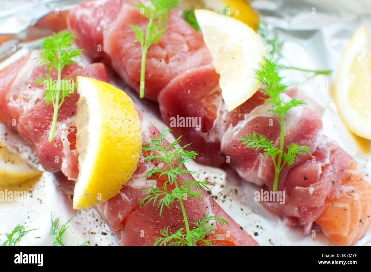 Bacon wrapped fresh salmon fillets - Stock Image