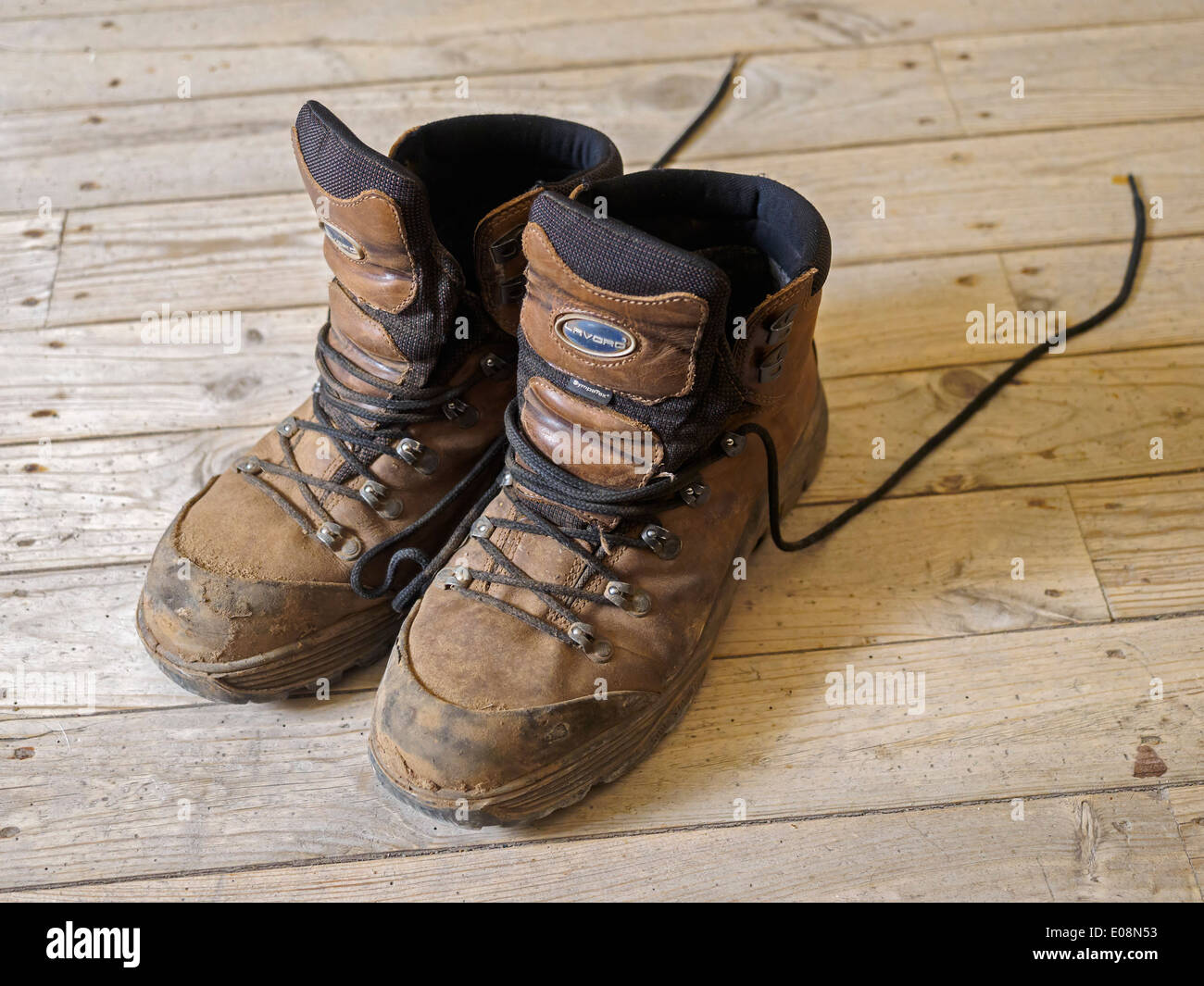 One pair of worn and dirty Lavoro brown walking boots Stock Photo