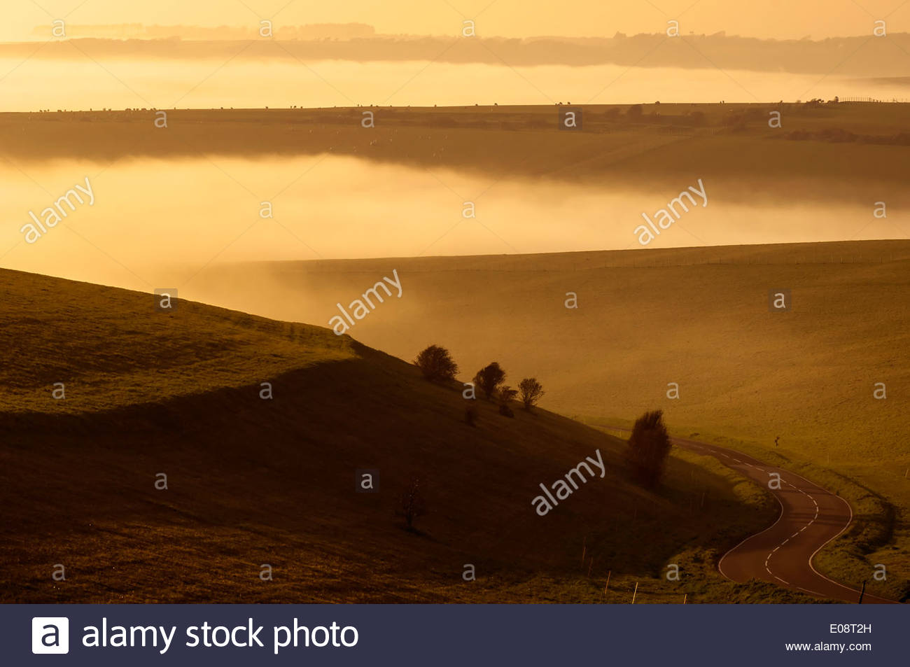 Twisting country road on a foggy day in eastbourne UK - Stock Image