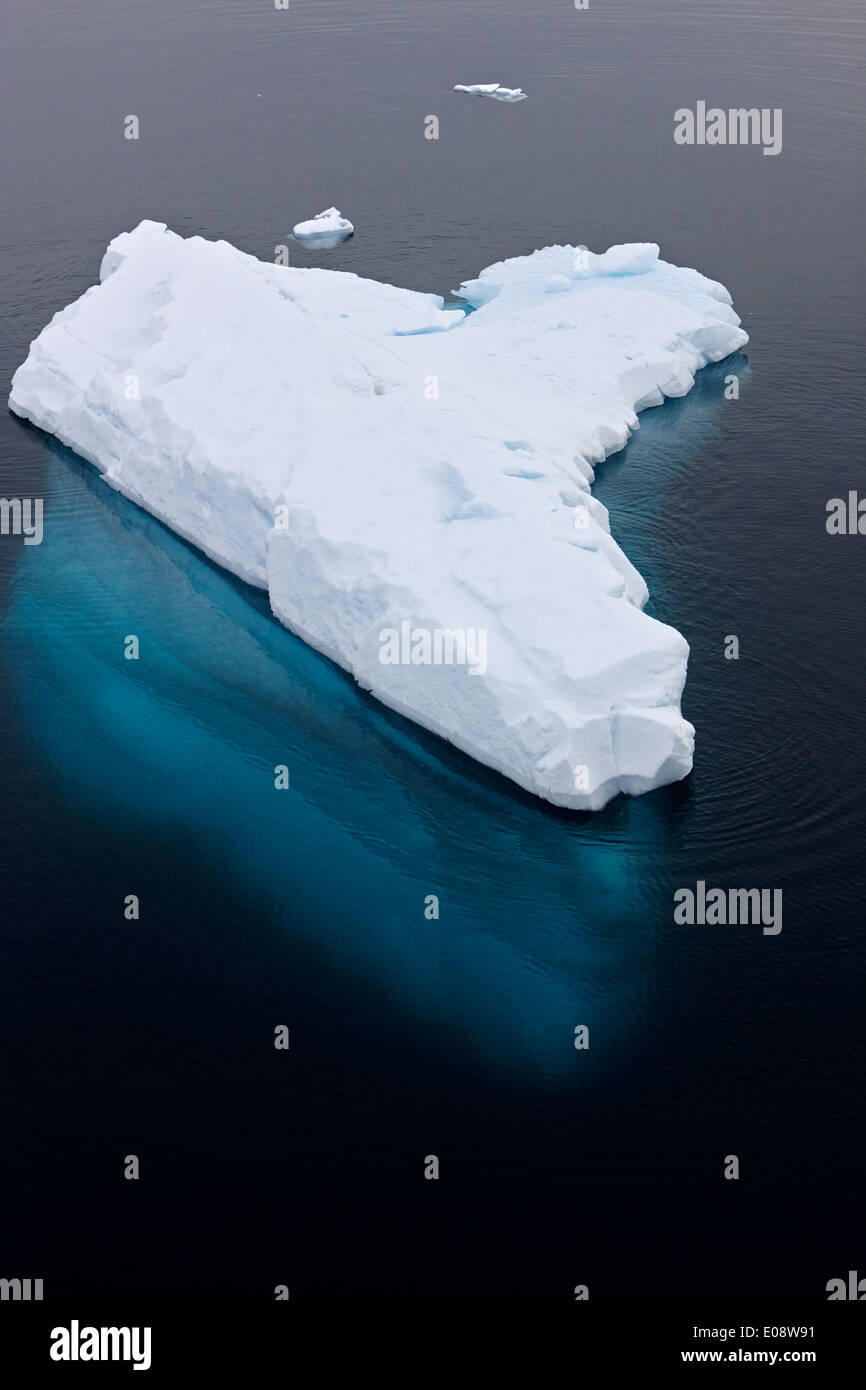 iceberg with small portion above waterline and huge volume below Antarctica - Stock Image